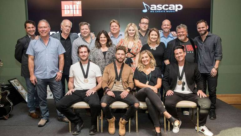 Pictured L-R: (back row) ASCAP's Michael Martin, Round Hill Music's Mark Brown, Big Yellow Dog's Kerry O'Neil, BMI's Bradley Collins, Big Yellow Dog's Carla Wallace, BMI's David Preston, ASCAP's Beth Brinker, Big Loud Records' Joey Moi, Major Bob's Music's Tina Crawford, Big Loud Records' Clay Hunnicut, Craig Wiseman and Seth England. (front row) Songwriter Abe Stoklasa, BMI artist Chris Lane and BMI songwriters Sarah Buxton and Jesse Erasure.