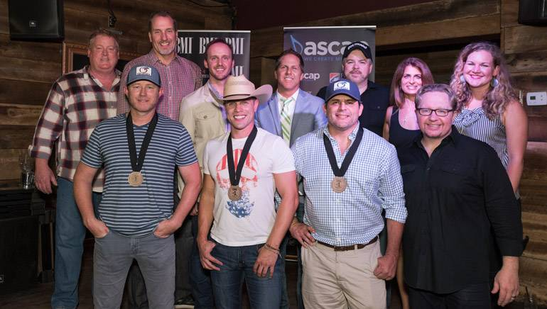 Pictured: (L-R): Back Row: ASCAP's Mike Sistad, Sony ATV's Tom Luteran, This Music's Rusty Gaston, Broken Bow Records' Jon Loba, Warner/Chappell's Ben Vaughn, Broken Bow Records' Lee Adams and BMI's Nina Carter. Front Row: Songwriter Ben Hayslip, BMI artist Dustin Lynch, BMI songwriter Rhett Akins and producer Mikey Jack Cones.