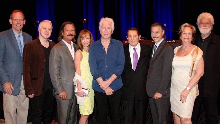 Pictured (L-R) BMI's Dan Spears, BMI songwriter and guitarist Shane Fontayne, BBGI President Bruce Beasley,  BBGI Interim CEO Caroline Beasley, BMI songwriter and artist Graham Nash, BBGI Chairman George Beasley, BBGI COO Brian Beasley, BBGI's Ann Beasley and Graham Nash's manager Buddha Miller.