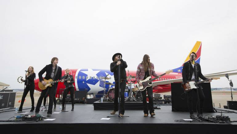 BMI artists A Thousand Horses perform in front of the newest Southwest Air plane.