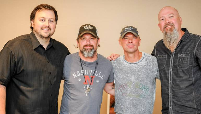 BMI's Mason Hunter, BMI songwriter Keith Gattis, BMI recording artist and songwriter Kenny Chesney and BMI songwriter Kendell Marvel pose for a photo at the Texas Roadhouse Managing Partners Conference.