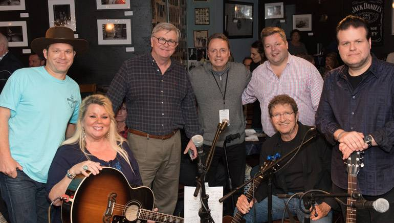 Pictured: (L-R): Standing:  BMI songwriter Scotty Emerick, BMI's Phil Graham, Jody Williams and Bradley Collins, BMI songwriter Bobby Tomberlin. Seated: BMI songwriters Leslie Satcher and Mac Davis.