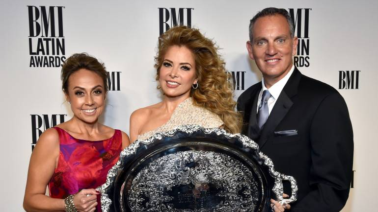 (L-R) BMI Vice President, Writer/Publisher Relations, Latin Music Delia Orjuela; honoree Gloria Trevi with the 2016 BMI President's Award; and BMI President & CEO Mike O'Neill attend the 23rd Annual BMI Latin Awards at the Beverly Wilshire Four Seasons Hotel on March 2, 2016 in Beverly Hills, California.