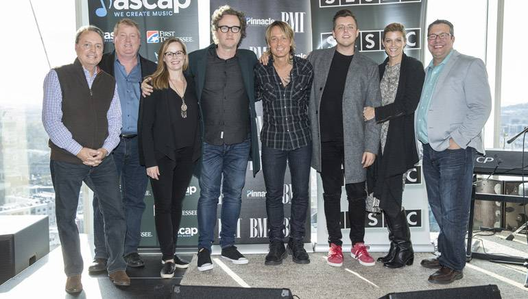 Pictured: (L-R): BMI's Jody Williams, ASCAP's Mike Sistad, BMG's Sara Knabe, ASCAP songwriter Greg Wells, BMI artist Keith Urban, SESAC songwriter JHart, SESAC's Shannon Hatch and Universal's Kent Earls.