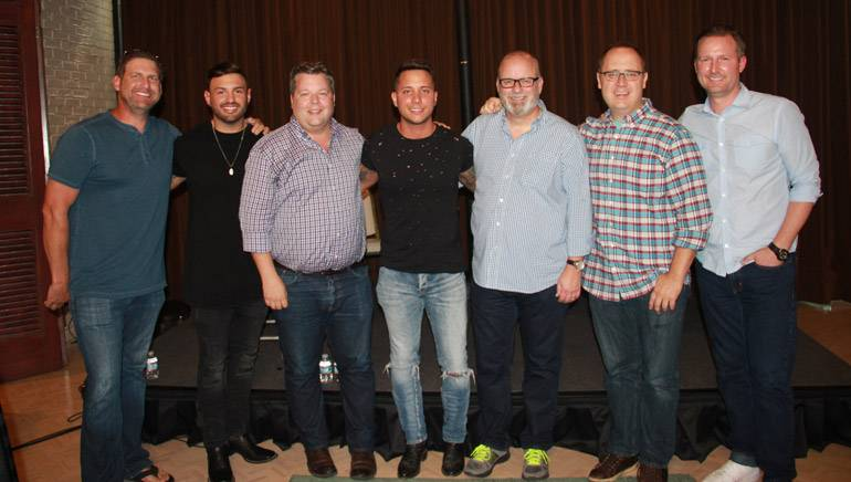 Pictured: (L-R): BMI songwriter Tommy Cecil, manager Zach Beebe, BMI's Bradley Collins, BMI singer-songwriter Carter Winter, producer Mark Bright, producer Chad Carlson, and APA's Jim Butler.