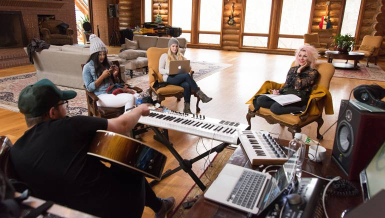 Pictured: (L to R): BMI songwriters Jordan Reynolds, Mickey Guyton, Sara Haze and Bonnie Mckee collaborate on a new track, using all available resources from the high-tech computer to low-tech notebook and instruments including guitar and piano.