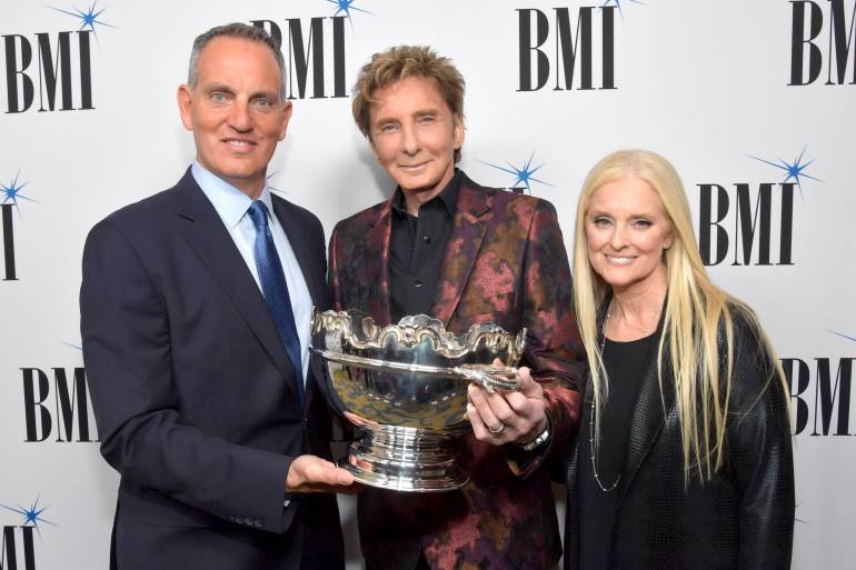 (L-R) BMI President and CEO Michael O'Neill, 2017 BMI Icon Award recipient Barry Manilow and BMI vice president and general manager, writer/publisher relations Barbara Cane at BMI honors Barry Manilow at the 65th Annual BMI Pop Awards