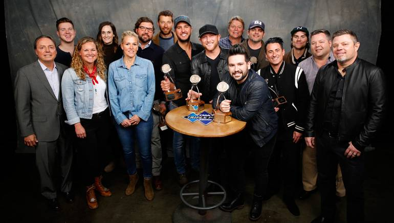 Pictured: (L-R): back row: BMI's Josh Tomlinson and MaryAnn Keen, BMI songwriters Dallas Davidson, Brett Eldredge and Luke Bryan, BMI's David Preston, BMI songwriters Rhett Akins and Ross Copperman. Front row: BMI's Jody Williams, Nina Carter and Leslie Roberts, BMI songwriters Cole Swindell, Shay Mooney and Jesse Frasure, BMI's Bradley Collins and BMI songwriter Rodney Clawson. (Not pictured: Carrie Underwood.)