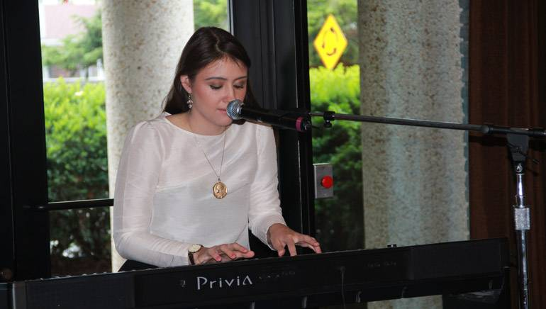 """BMI hosted a reception June 12, 2017, for theBMI Foundation's Second Annual Nashville Songwriting Scholarshipwinner Angelica Rose Toumbas. Toumbas treated the crowd to two of her original songs, including her award-winning """"The Feeling of Almost."""""""