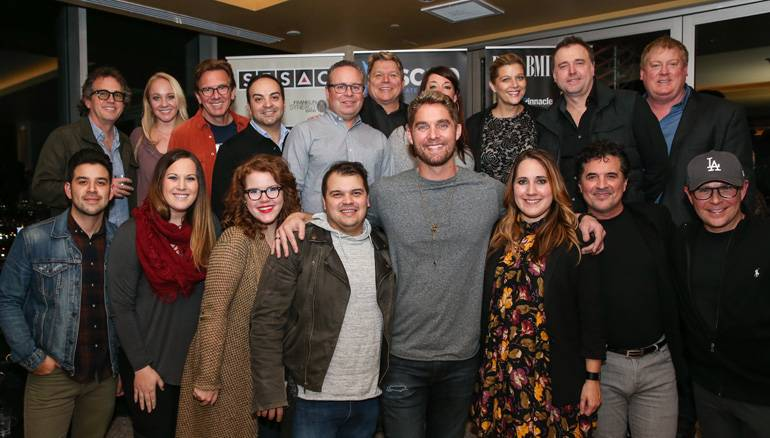 Pictured: (L-R): Back row: Producer and engineer Justin Niebank, Big Machine's Laurel Kittleson, producer Dann Huff, Big Machine's Mike Molinar, Downtown Publishing's Steve Markland, BMI's David Preston, Word Publishing's Janine Appleton, SESAC's Shannon Hatch, Red Creative's Jeremy Stover and ASCAP's Mike Sistad. Front row: Downtown Publishing's Danny Berrios, Red Creative's Brooke Antonakos, Downtown Publishing's Natalie Osborne, songwriter Justin Ebach, singer/songwriter Brett Young, BMI songwriter Kelly Archer, Big Machine's Scott Borchetta and Jimmy Harnen.