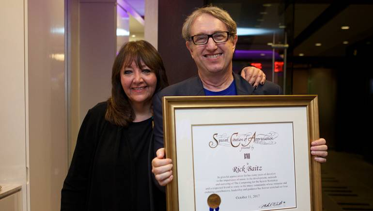 "BMI Vice President Film, TV & Visual Media Relations Doreen Ringer-Ross presents BMI composer Rick Baitz with a certificate of appreciation during the reception celebrating 10 years of the ""Composing for the Screen"" workshop."