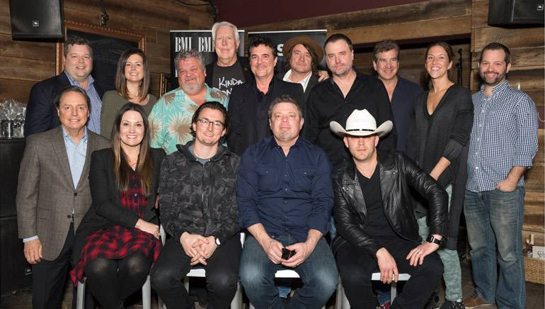 Pictured (L-R - Back row): BMI's Bradley Collins, Creative Nation's Beth Laird, Big Loud Shirt's Craig Wiseman, Big Machine's George Briner and producer Scott Borchetta, producers Julian Raymond and Jeremy Stover Pulse Song's Scott Cutler, Round Hill's Penny Gattis and Big Loud Shirt's Seth England. (Front row): BMI's Jody Williams, BMI songwriter Natalie Hemby, songwriter Matt Dragsteam, BMI songwriter Rodney Clawson and BMI artist Justin Moore.