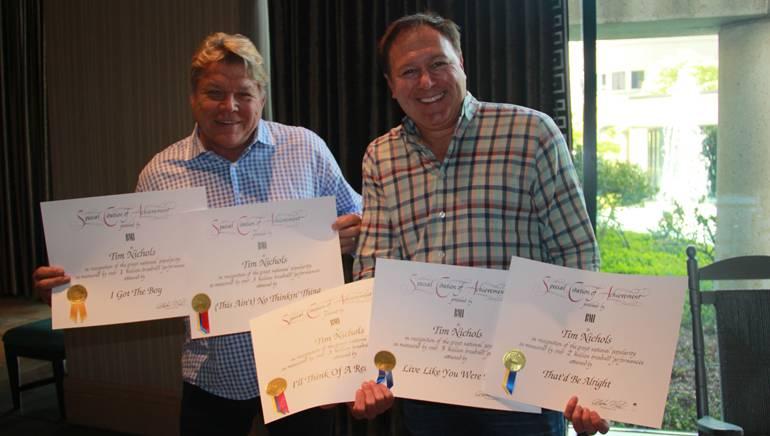 BMI's David Preston and BMI songwriter Tim Nichols celebrate Tim's Million-Air awards.