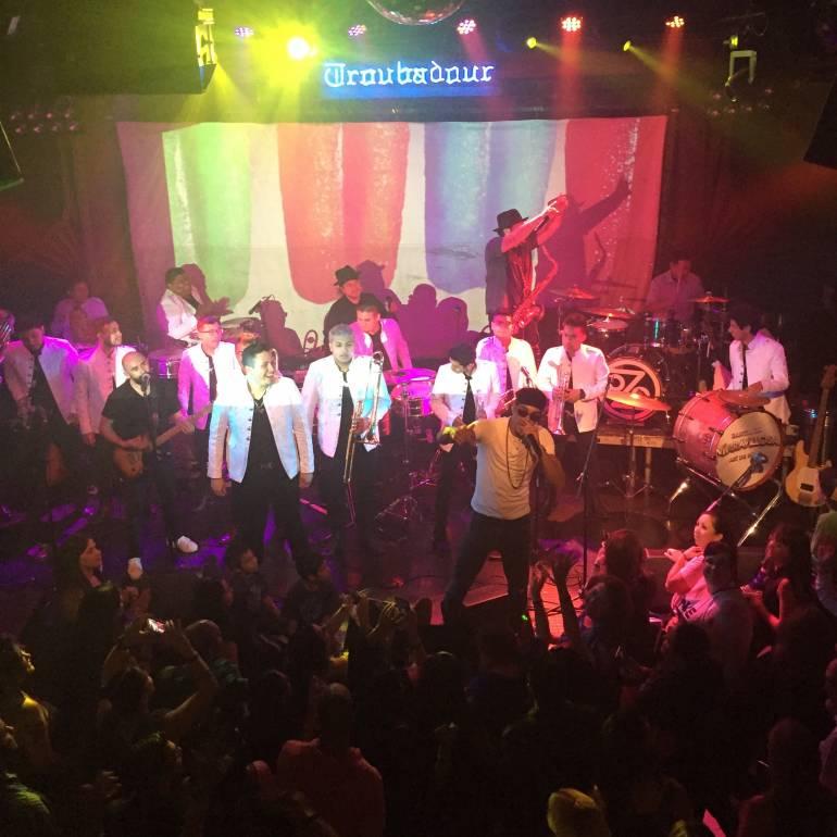 Ozomatli shares the stage with Banda La Maravillosa at Los Angeles' legendary Troubadour.