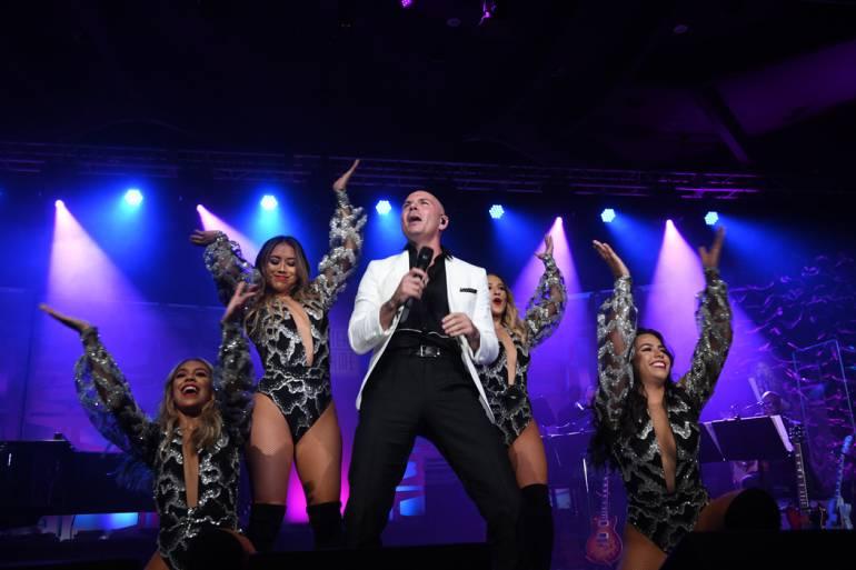 Global Ambassador Award recipient Pitbull closes the night with a high-energy performance.