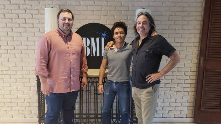 BMI's Mason Hunter with songwriters Alejandro Sierra and James Slater.