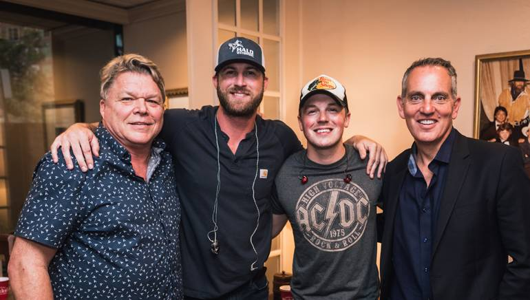 BMI's David Preston, Riley Green, Travis Denning and BMI's Mike O'Neill gather backstage at BMI's Rooftop On The Row.