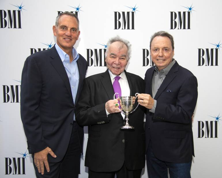 BMI's Mike O'Neill, Troubadour Award recipient John Prine and BMI's VP, Creative, Nashville Jody Williams gather for a photo at BMI's Nashville office on September 10, 2018