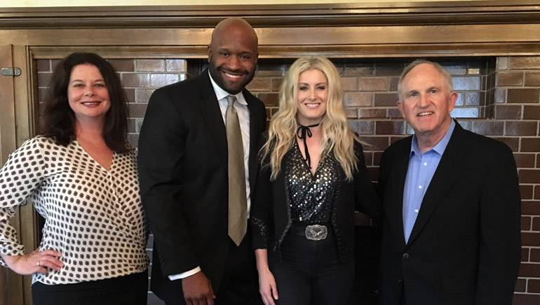 """BMI's Jessica Frost; GRAMMY/Dove/Emmy Award-winning BMI songwriter and producer/program director 102.1 """"The Ville,"""" Shannon Sanders; BMI songwriter Stephanie Quayle; and President and CEO of The Cromwell Group, Bud Walters, gather for a photo before the performance."""