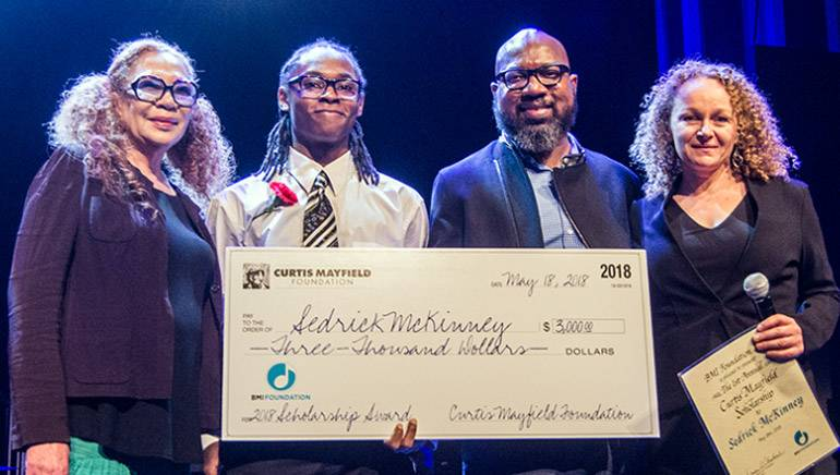 Pictured (L-R) are: Altheida (Mrs. Curtis) Mayfield, scholarship recipient Sedrick McKinney, Curtis' son Cheaa Mayfield and BMI Foundation President Deirdre Chadwick.