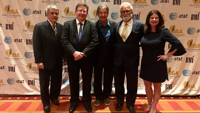 Pictured (L-R) at the IBA's Silver Dome awards dinner are: National Association of Broadcasters Senior Advisor and 2018 IBA Lifetime Achievement Award recipient John David, IBA President and CEO Dennis Lyle, BMI singer-songwriter Terry Sylvester, IBA Board Chair and Vice President/General Manager Quincy Broadcasting Carlos Fernandez and BMI's Jessica Frost.