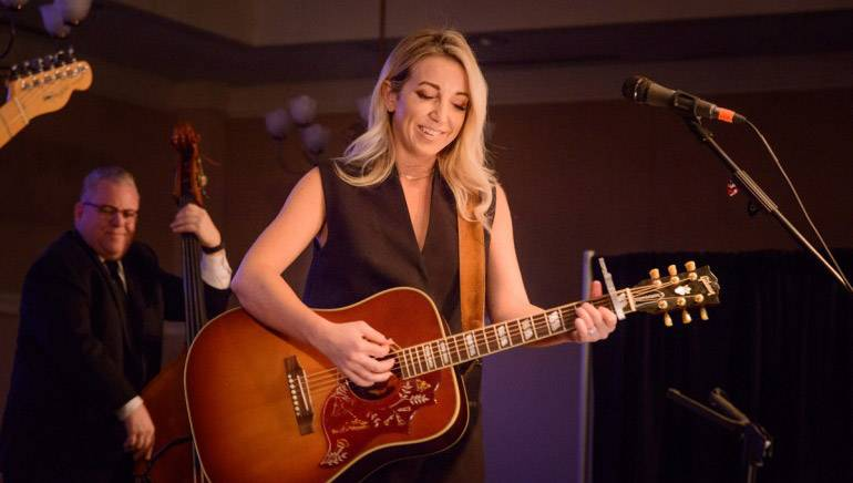 BMI songwriter Ashley Monroe strums her guitar at one of the songwriter-in-the-round events at BMI Icon Dean Dillon's 2017 Mountain High Music Festival.