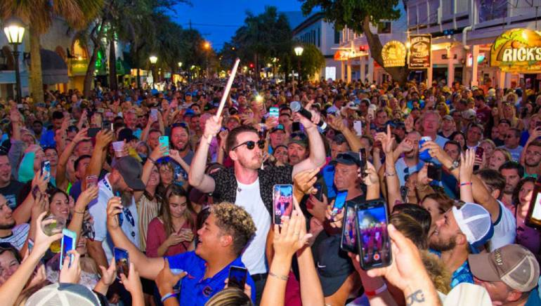 Brandon Lancaster of LANCO performs in the crowd at the Duval Street Stage during the Key West Songwriters Festival on May 12, 2018, in Key West, Florida.