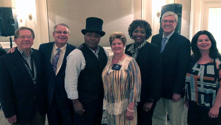 Pictured (L-R) after Chris' electrifying performance are: MAB Board Chair and Retired iHeart Media executive Kenny Windham, LAB Board Chair and KATC-TV President/GM Andrew D. Shenkan, BMI songwriter Chris Thomas King, LAB President and CEO Polly Johnson, MAB President and CEO Karla Hooten, National Association of Broadcasters President and CEO Senator Gordon Smith and BMI's Jessica Frost.