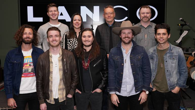Pictured (L-R front row) at the No. 1 party are: lead guitarist Eric Steedly, lead singer and BMI songwriter Brandon Lancaster, drummer Tripp Howell, multi-instrumentalist Jared Hampton and bassist Chandler Baldwin. (back row): BMI's Josh Tomlinson, Neon Cross' Melissa Spillman, Sony Music Nashville's Chairman and CEO Randy Goodman, Warner Chappell's Ben Vaughn.
