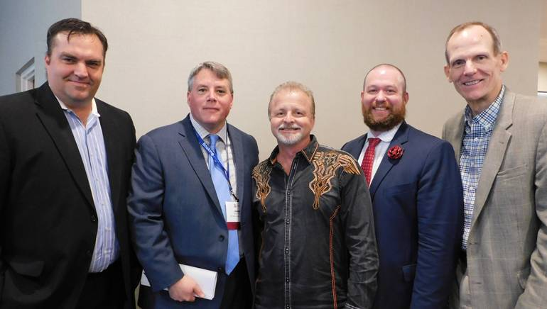 Pictured (L-R) before Myers' performance at the OH&LA awards luncheon in Cleveland are: Aloft Cleveland Downtown GM Bill Reed, OH&LA Executive Director Joe Savarise, BMI songwriter Frank Myers, Kimpton Schofield Assistant GM Tristan Haas and BMI's Dan Spears.