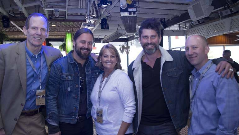 Pictured (L-R) after the performance at Fager's Island are: BMI's Dan Spears, BMI songwriter Hugh Mitchell, RAM Chairman Elect and Golden Corral Regional VP Kathie Sewell, BMI songwriter Dave Pahanish and RAM President/CEO Marshall Weston.
