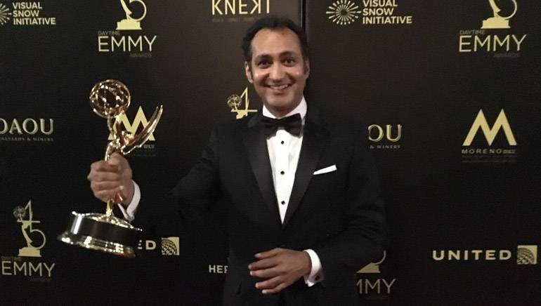 Pictured with his Emmy is Vivek Maddala.