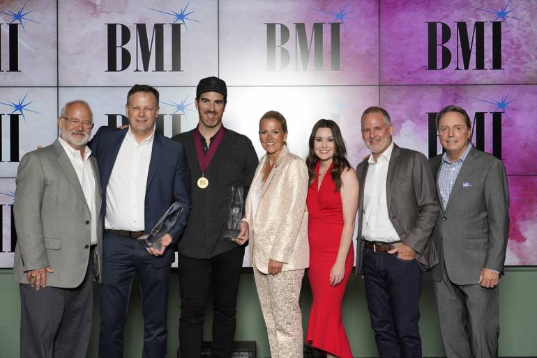 Al Andrews of Porter's Call, Capitol CMG's Brad O'Donnell, Songwriter of the Year Ed Cash, BMI's Leslie Roberts, Capitol CMG's Karrie Dawley, Capitol CMG's Jimi Williams, and BMI's Jody Williams
