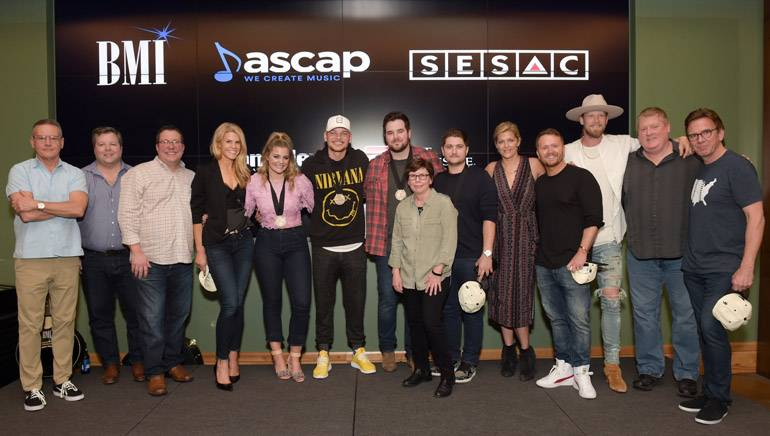 (L-R): Sony Music Nashville's Randy Goodman, BMI's Bradley Collins, Universal Music Publishing's Kent Earls, Martha Earls, Lauren Alaina, Kane Brown, Matt McGinn, SMACK's Robin Palmer, Jordan Schmidt, SESAC's Shannan Hatch, SMACK's Shane McAnally, Tree Vibez Music's Brian Kelley, ASCAP's Mike Sistad and Dann Huff.