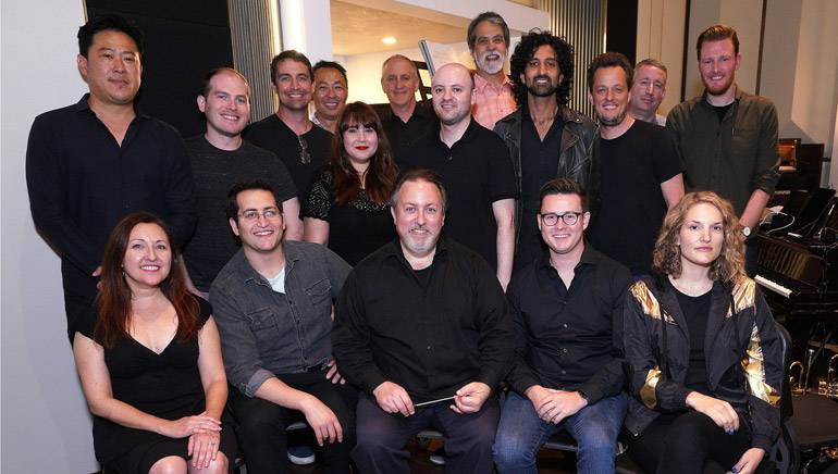 Pictured (L-R) at the BMI conducting workshop are (front row): BMI composer Cindy O'Connor, BMI composer Ben Bromfield, BMI composer and conductor Lucas Richman, BMI composer Andy Forsberg and BMI composer Genevieve Vincent. Back row (L-R): BMI composer Timo Chen, BMI composer Alex Bornstein, BMI composer Peter Karr, BMI's Ray Yee and Evelyn Rascon, musician contractor David Low, BMI's Philip Shrut, Music Editor Chris Ledesma, BMI composer Oumi Kapila, BMI composer/ Bandrika studio owner Nate Barr, concertmaster Mark Robertson and BMI's Chris Dampier.