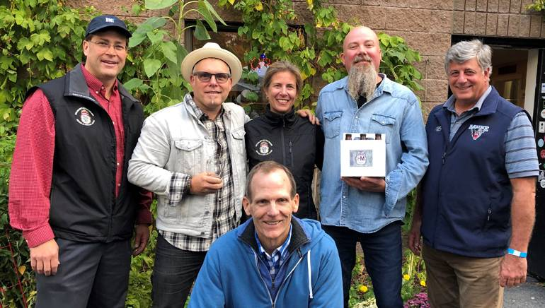Pictured (L-R) before the performance at Geary's Brewing are (standing):Geary's Brewing co-owner Alan LaPoint, BMI songwriter Danny Myrick, Geary's co-owner Robin LaPoint, BMI songwriter Kendell Marvel and HospitalityMaine CEO Steve Hewins. (Kneeling): BMI's Dan Spears.