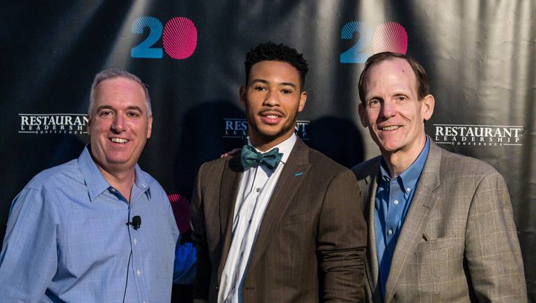Pictured (L-R) before Joe Maye's performance at RLC 2018 are: Winsight Media Group President of Restaurant Media and Events Chris Keating, BMI songwriter Joe Maye and BMI's Dan Spears.