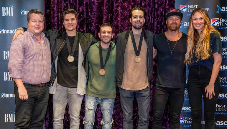 """Pictured: BMI's Bradley Collins, Steven Lee Olsen, David Garcia, Josh Miller, Kip Moore and ASCAP's Evyn Mustoe gather for a photo at the celebration honoring """"More Girls Like You."""""""