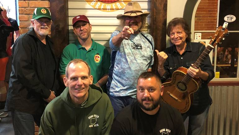 Pictured (L-R) before the performance at The Laird Arcade Brewery in Tiffin, OH are (standing):BMI songwriter Aaron Barker, The Laird Arcade Brewery co-owner Eric Kuebler and BMI songwriters Earl Bud Lee and Even Stevens. (Kneeling): BMI's Dan Spears and The Laird Arcade Brewery co-owner Andy Flechtner.