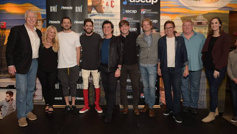 BMLG's George Briner and Allison Jones, BMI songwriters Julian Bunetta and Thomas Rhett, BMLG's Scott Borchetta, songwriter Dave Barnes, BMG's Kos Weaver, Dann Huff, Mike Sistad and BMI's MaryAnn Keen gather for a photo at Von Elrod's in Nashville.