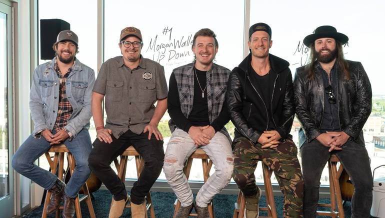 "BMI songwriters Brad Clawson, Michael Hardy (HARDY), Morgan Wallen, Tyler Hubbard and ASCAP songwriter CJ Solar gather for a photo while celebrating their Number One hit ""Up Down."""