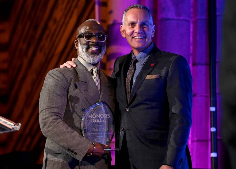 BeBe Winans presents BMI President and CEO Mike O'Neill with the T.J. Martell Foundation's Legacy Award.