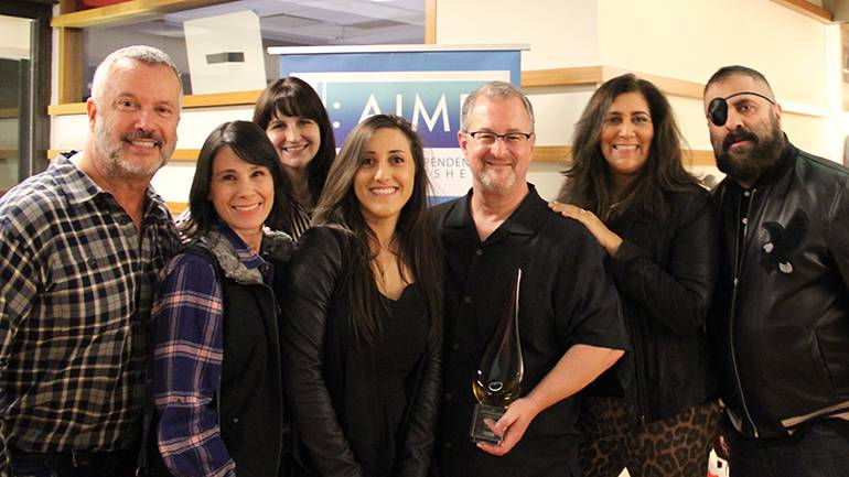 The PEN Music Group team accepts their award for Indie Publisher of the Year during the AIMP holiday party, held at BMI's Los Angeles office on December 5. Pictured (L-R) are Patrick Conseil, Nikki Discola, Karen Falzone, Rebecca Valice, Michael Eames, Mallory Zumbach and Mark Nubar.