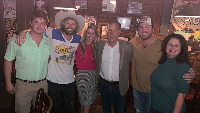 Gathered for a photo before the performance at Alchemy in Mobile, AL are: Director of Grassroots & Chapter Development JB Hampton, BMI singer-songwriter Paul McDonald, ARHA Senior Director of Membership Shea Perkins, Visit Mobile President & CEO David Clark, BMI singer-songwriter Tyler Reeve and BMI's Jessica Frost.
