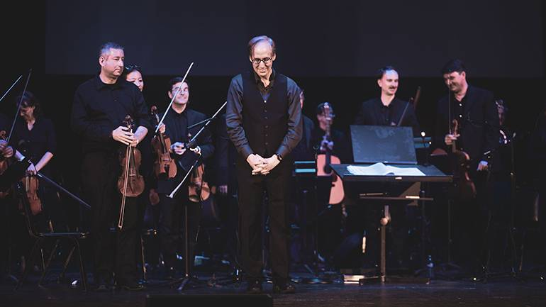 Composer Jeff Beal takes a bow to a standing ovation at the Wiltern at the end of the Biggest Little Farm Live concert.