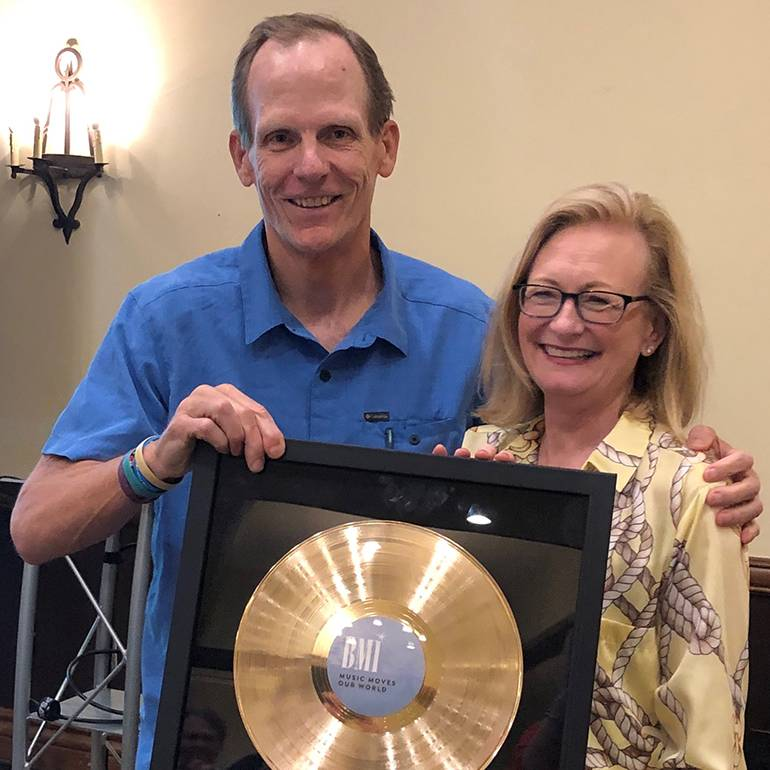BMI's Dan Spears presents NRA CEO Dawn Sweeney with a BMI gold record at the CSRA summer meeting in Sonoma.