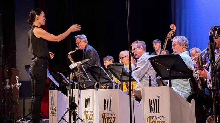 """Last year's Charlie Parker Prize winner and Manny Albam Commission recipient, Jihye Lee, conducts her winning composition, """"Unshakeable Mind,"""" at the 30th annual summer showcase."""