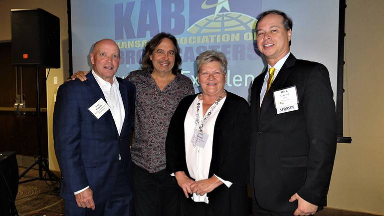 Gathered for a photo are: Kansas Associations of Broadcasters' President, Kent Cornish, BMI songwriter James Slater, Kansas Association of Broadcasters' Judy Clouse and BMI's Rick Schrock.