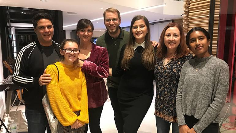 Pictured (L-R) are: mentor Tony Morales, student Sera Hornstein, mentor Rebecca Kneubuhl, University High School music director Micah Byers, student Francesca Borchardt, mentor Cindy O'Connor and student Charu Balamurugan during a recording session for the Uni Music Mentorship program in Venice, CA, on November 25.