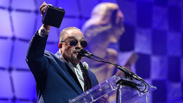 Willie Colón celebrates his induction into the Latin Songwriters Hall of Fame's 7th Annual La Musa Awards.